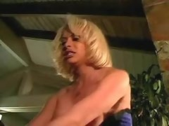 Attractive blond shemale enjoys dominating guy in loft