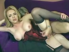 Glamour mature shemale in corset sexing on sofa