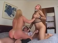 Straight girl fucked by two horny shemales on bed