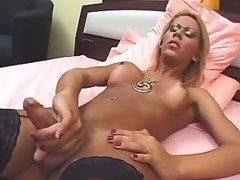 Glamour shemale in high boots wanks