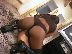 Ebony shemale gets cum on high boot