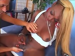 Exotic ebony shemale jizzes on blue sofa n gets BJ