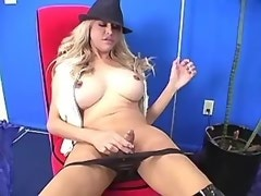 Chesty shemale in leather trousers plays with cock