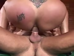 Brunette tranny gets deep fucked on billiard table
