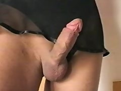 Glamour sexy tranny masturbates and cums on stairs