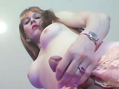 Tall shemale plays with her cock and fucks herself