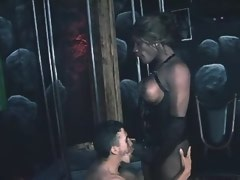 Hot ebony tranny in corset gets blowjob from bloke