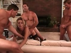 Blond tranny in stockings gets cum after group sex