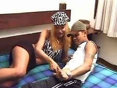 Tgirl in sexy cap fucks on wide bed