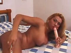 Lonely shemale with big boobs has fun with sextoys