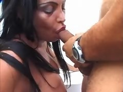 Longhaired shemale making sensual oral job outdoors