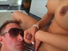 Bloke gets cumshot from playful beautiful shemale