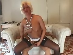 Lewd shemale in stockings jumps on cock and jizz