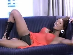Buxom black shemale masturbates and jizzes on sofa