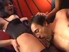 Slave guy gets cumshot from hot tranny in treesome