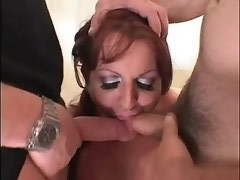 Shemale catches powerful cumshot in threesome orgy