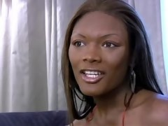 Ardent ebony shemale poses and masturbates on sofa