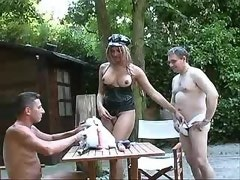 Busty depraved shemale serves horny men outdoor