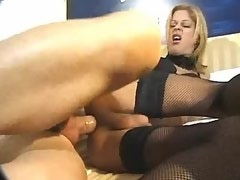 Charming blonde shemale in stockings get fucked on bed