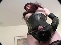 Hot shemale couple in corsets compares their cocks