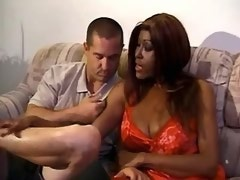 Lewd exotic shemale in red and man suck each other