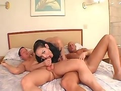Nice busty shemale greedily throats two cocks