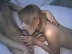 Two cute Asian shemales suck each other on bed
