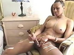 Mulatto shemale with big cock masturbates and cums